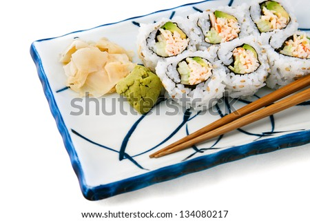 Japanese food - california roll served with wasabi and ginger.  White background - stock photo