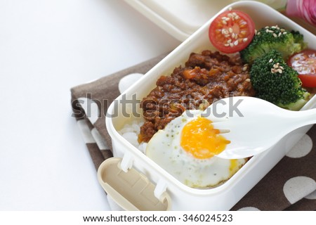 Japanese food, fusion bento keema and quail egg packed lunch  - stock photo