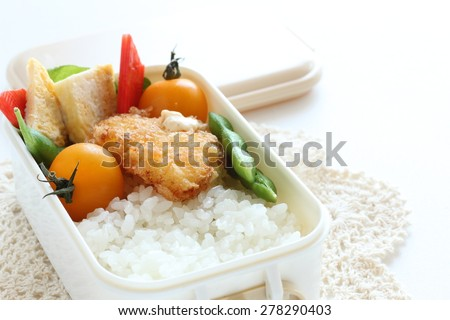 Japanese food, homemade packed lunch Fried fillet and vegetable with rice - stock photo