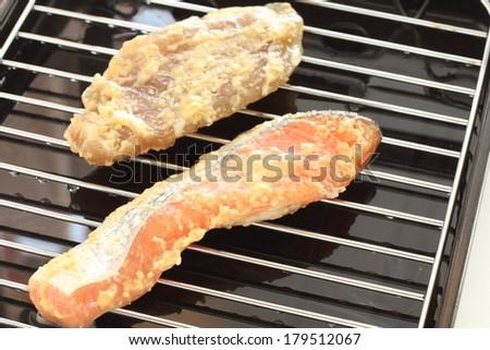 Japanese food ingredient, miso marinated fish Saikyotsuke on grill pan - stock photo