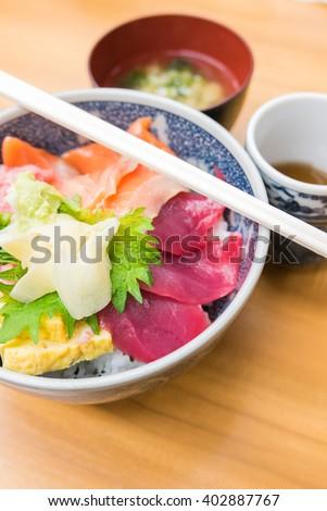 Japanese food- Salmon and negitoro tuna, sashimi raw fish seafood rice bowl, sashimi on rice, donburi - stock photo