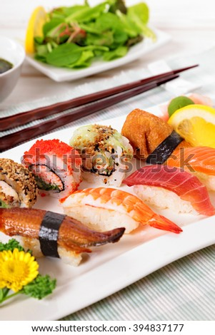 Japanese food sushi plate with chopsticks, vertical - stock photo