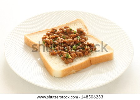 Japanese fusion food, Natto on bread for healthy food image - stock photo