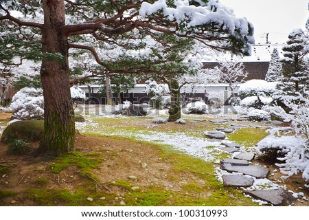 Japanese Garden Covered with Snow at Takayama Jinya - stock photo