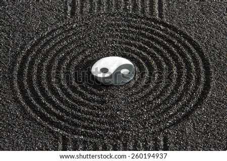 Japanese garden with stone in sand - stock photo