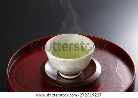 Japanese green tea in porcelain cup - stock photo