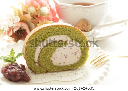 Japanese green tea swiss roll with red bean cream - stock photo