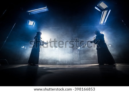 Japanese kendo fighters to fight. - stock photo