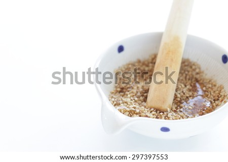 Japanese kitchen utensil, suribachi pestle and mortars with sesame - stock photo