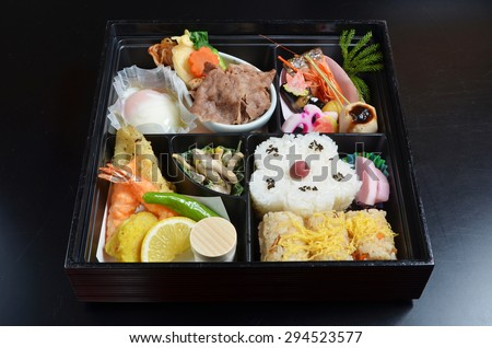 Japanese lunch box on black background - stock photo