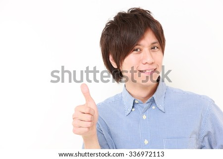 Japanese man with thumbs up gesture - stock photo