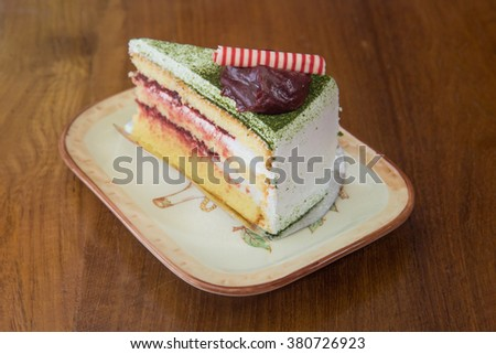 Japanese Matcha Green tea cake with red bean jam topping in vintage and light leak color style - stock photo