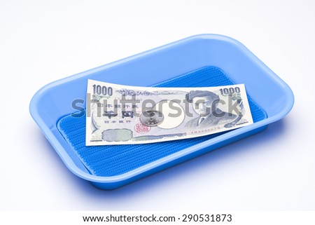 japanese money in payment tray - stock photo