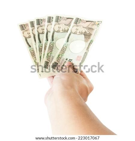 Japanese money Yen in hand - stock photo