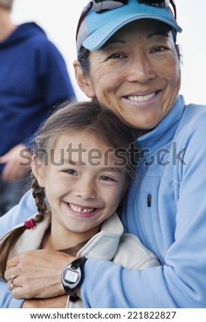 Japanese mother and daughter hugging - stock photo
