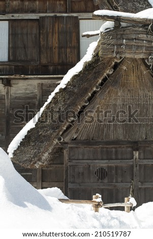 Japanese mountain thatched roof house with snow - stock photo
