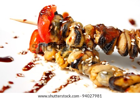 Japanese mussels kebabs. Traditional Oriental food. Tasty and nutritious - stock photo