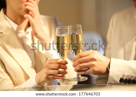 Japanese office lady and businessmen toasting - stock photo