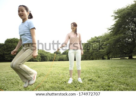 Japanese Parent and child to jump rope - stock photo