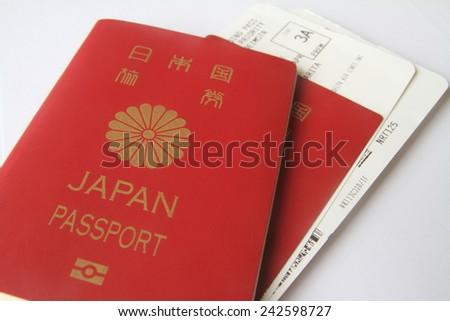 Japanese passport and boarding pass - stock photo