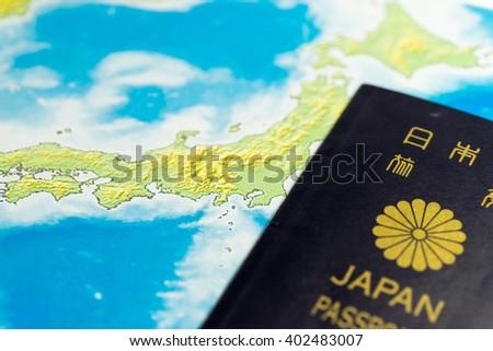 Japanese passport and map - stock photo