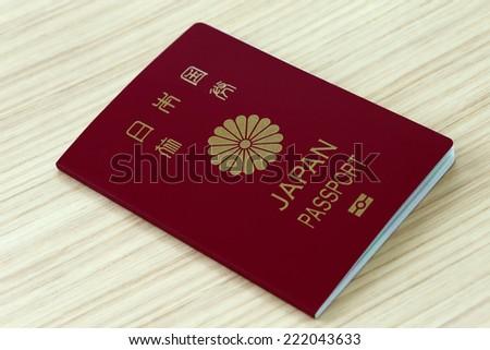 Japanese passport on the desk - stock photo