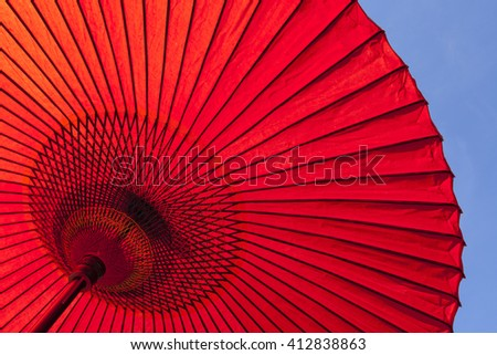 Japanese red oil-paper umbrella. - stock photo