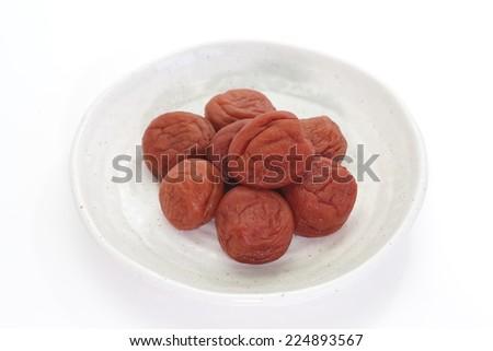 Japanese salt plum or pickled plum on white background  - stock photo