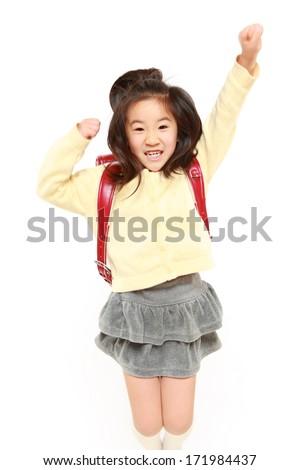 Japanese School Girl Jumps - stock photo
