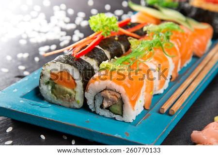 Japanese seafood sushi set on stone table, close-up. - stock photo
