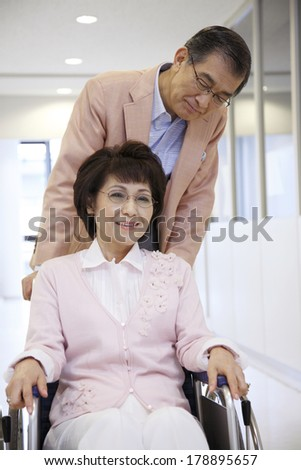 Japanese senior woman in a wheel chair  - stock photo