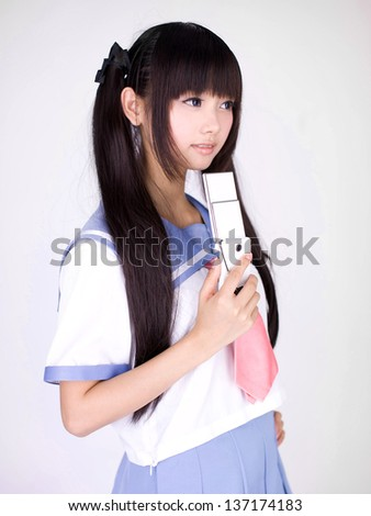 japanese student girl with phone - stock photo