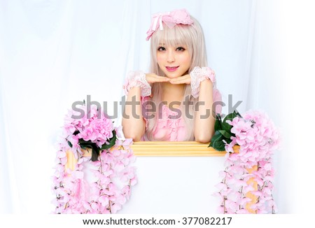 japanese style cute girl with flowers board - stock photo