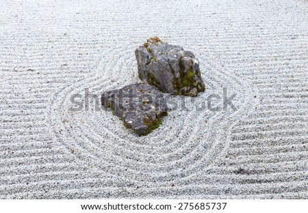 Japanese style garden with rocks and raked gravel - stock photo