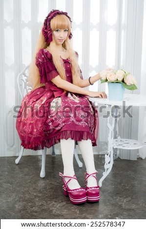 japanese style lolita maid cosplay cute girl - stock photo