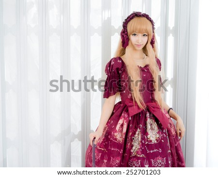 japanese style lolita maid cosplay cute girl - stock photo