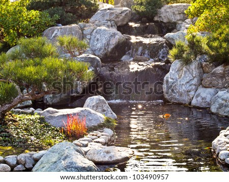 Garden pond stock photos images pictures shutterstock for Japanese style pond