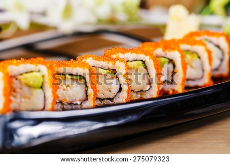 Japanese sushi rolls with red caviar - stock photo