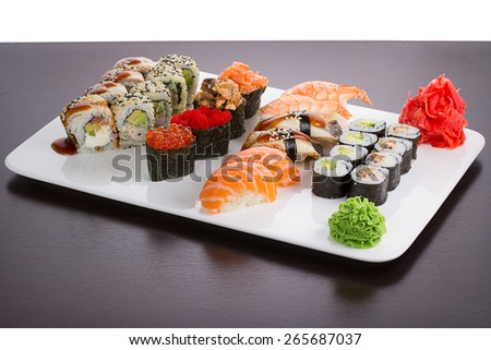 Japanese tasty sushi set on white plate - stock photo
