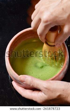 Japanese tea ceremony,Matcha tea prepared with bamboo whisk - stock photo