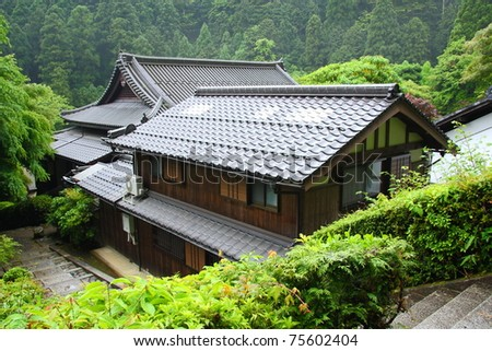 Japanese temple in the green forest (near Kyoto) - stock photo