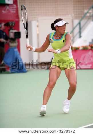 Japanese tennis star Ai Sugiyama during her defeat of Anastasia Myskina at the Qatar Total Open, Doha, March 2006. - stock photo