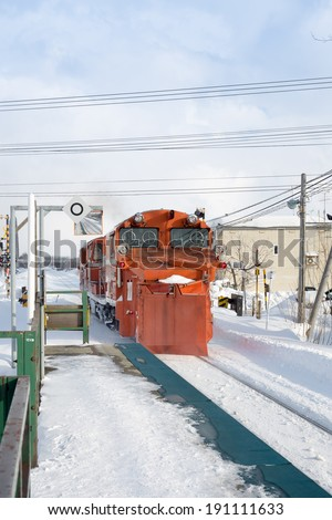 japanese train on snow track - stock photo