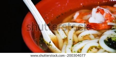 Japanese Udon Noodle Soup with shrimps.  - stock photo