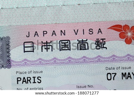 Japanese visa in a passport (obtained in Paris) - stock photo