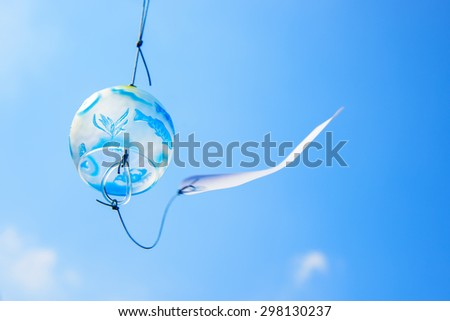 Japanese wind chime against blue sky - stock photo