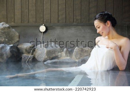 japanese woman in hot spring. - stock photo