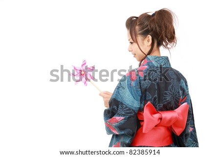 Japanese woman in traditional clothes of Kimono with pinwheel - stock photo
