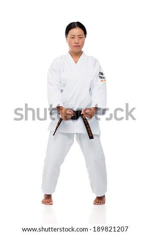Japanese woman practicing karate - stock photo