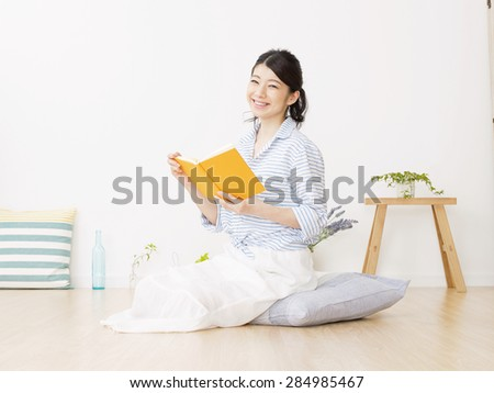 Japanese woman reading a book - stock photo